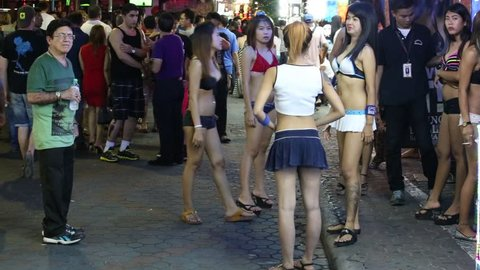 PATTAYA, THAILAND - NOVEMBER 15, 2014: Walking Street is red-light district with many restaurants, go-go bars and brothels, that draws people, primarily for night life and sexual entertainments