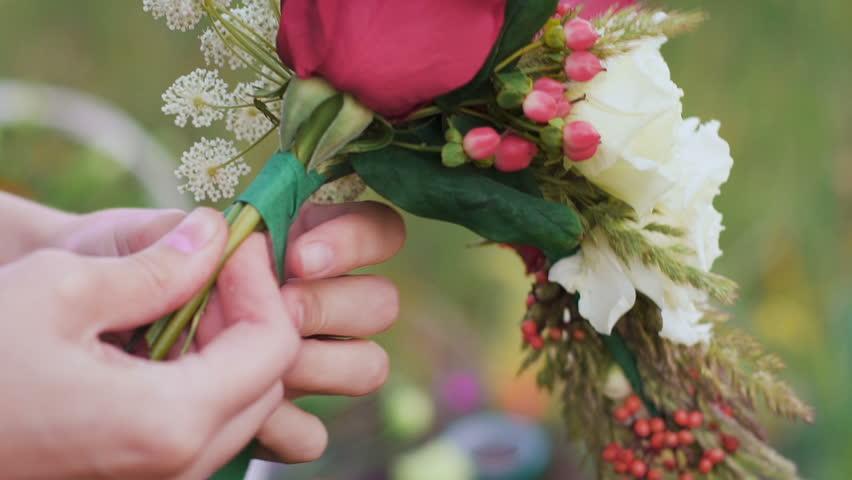 Making a flower bunch on the green field. | Shutterstock HD Video #18288613