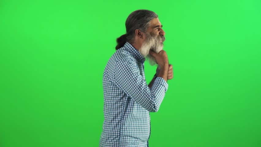 Bearded grown man fixing his clothes and beard while walking in a medium sideways over a green screen. | Shutterstock HD Video #18292651