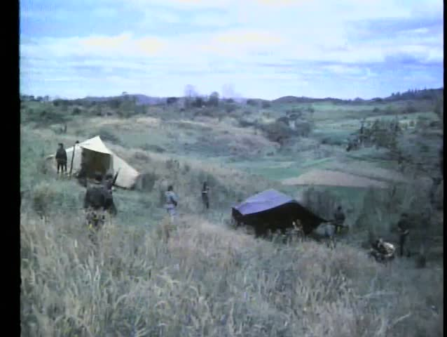 Soldiers patroling hillside Army camp