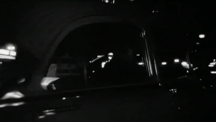 Police cruiser following car at night