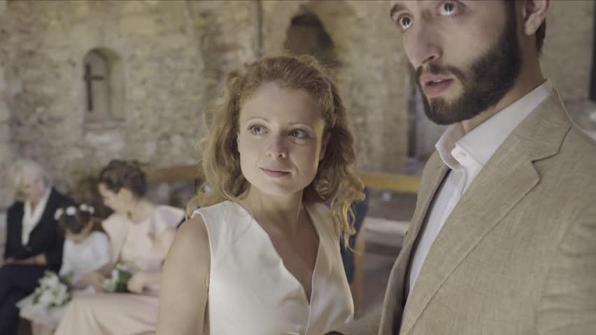 Priest pronouncing couple married | Shutterstock HD Video #18358921