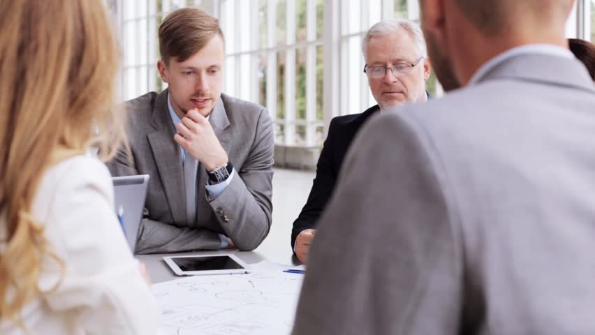 People, planning, strategy and corporate concept - business team with scheme meeting and discussing problem at office | Shutterstock HD Video #18359401
