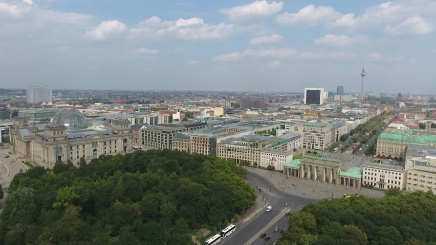 Berlin Brandenburg Gate aerial view with city traffic on 17 june street.
