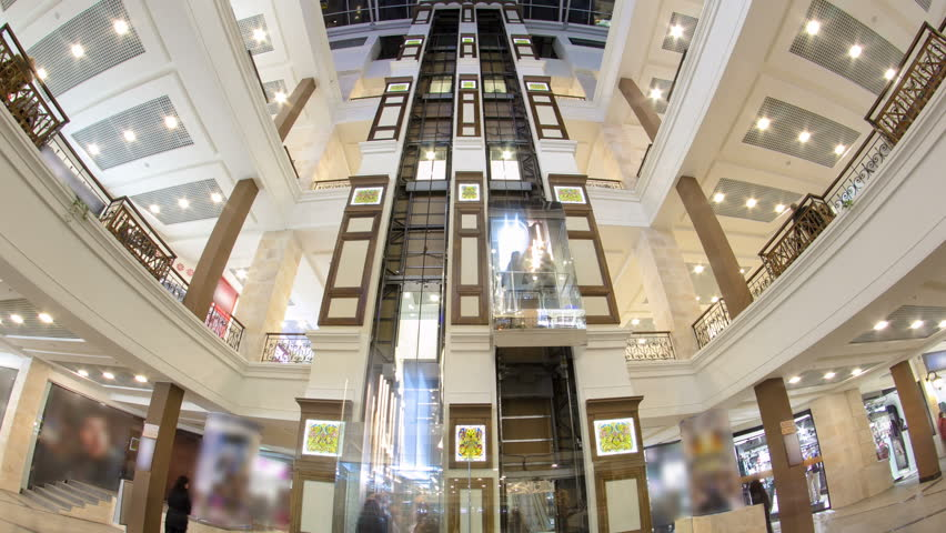 MOSCOW, RUSSIA - CIRCA SEPTEMBER 2015: Motion elevators at the modern shopping mall timelapse hyperlapse. a multi-storey shopping center | Shutterstock HD Video #18378175