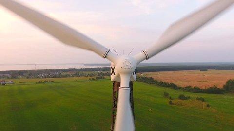Aerial View. Beautiful windmill turbines sunset , wind energy turbines . Aerial drone shot. 4K 30fps