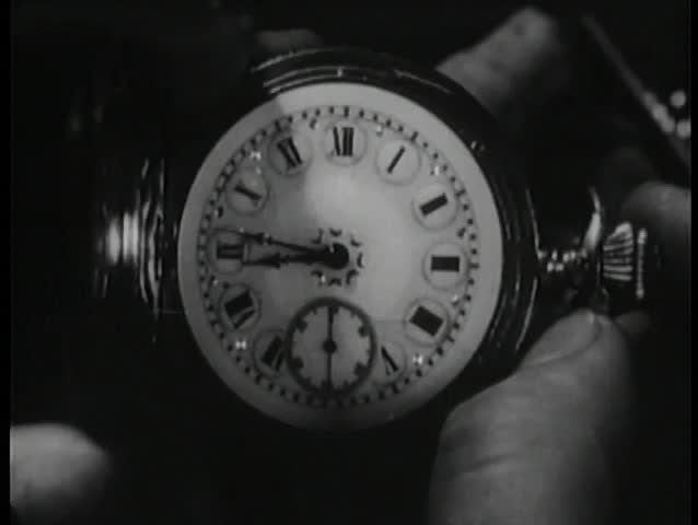 Close-up of pocket watch and passage of time