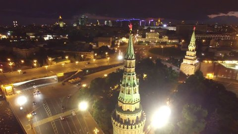 Approach to kremlin star. Best unique night flight close to Moscow Kremlin and Red Square. Evening embankment road traffic. City illumination. 4k footage. Aerial drone quadcopter.