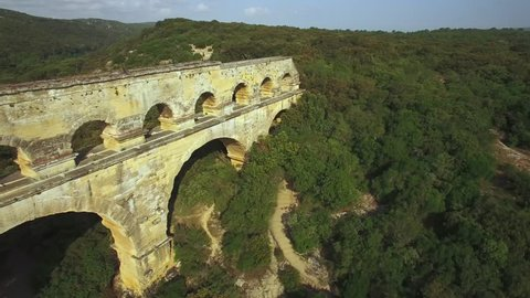 Europe, France, Gard, aerial view of the roman Bridge over the Gard river, le pont du Gard listed as World Heritage by UNESCO, 4k movie (3820 x 2160)