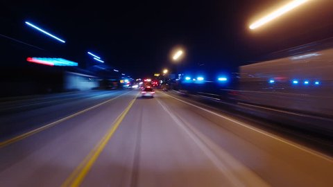 Hyperlapsed view from a car at night. POV. Freeway. Los Angeles, United States. Perfect to represent concepts as autonomous driving, futuristic cityscape, city life, transportation, etc.
