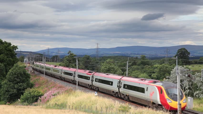HACKTHORPE, ENGLAND - AUGUST 6:  A Virgin Pendolino heads north through Hackthorpe, Cumbria on August 6, 2016.  Virgin trains have operated the UK west coast main line rail franchise since 1987.