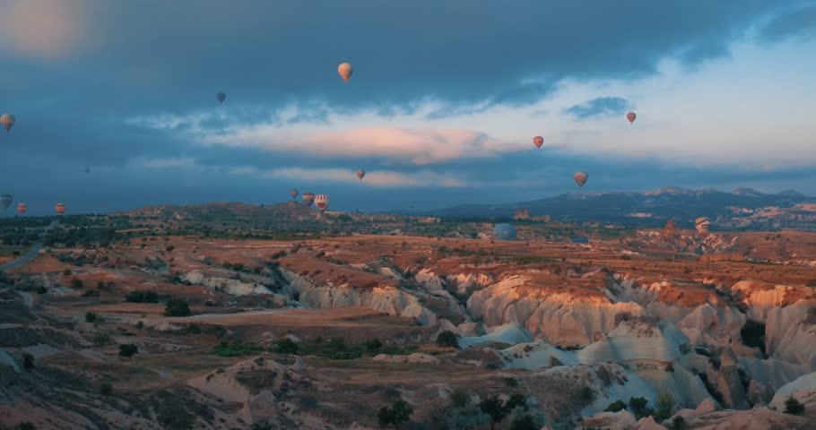 4K Aeriel view of Goreme. Colorful hot air balloons flying over the valleys on July 2016, Famous city Cappadocia, Turkey.