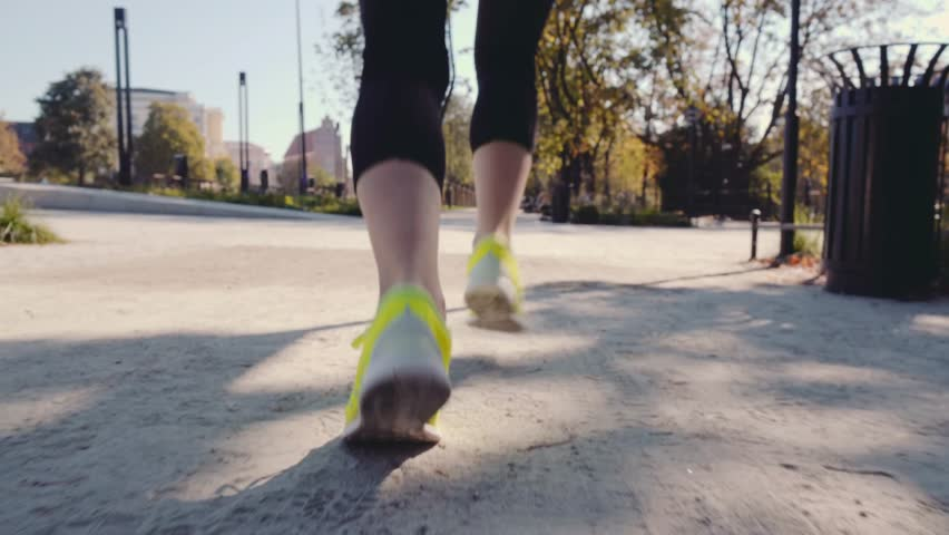 Runner Woman Feet in the City Exercising Outdoors, 4K CLOSE UP. Steadicam STABILIZED shot. Young Sportswoman in barefoot Sports Shoes training on the sunny city park road. Healthy Lifestyle #18640811