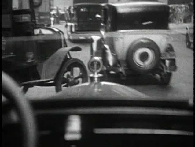 Point of view of car driving on crowded city street
