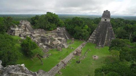 Great aerial shot over the Tikal pyramids in Guatemala. (Guatemala 2010s)