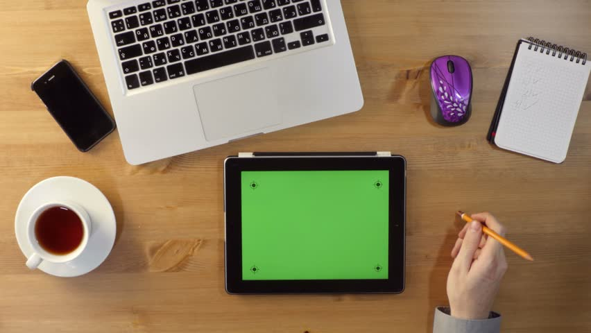 Using Tablet PC and with a Green Screen at the Desktop.Top View | Shutterstock HD Video #18770051