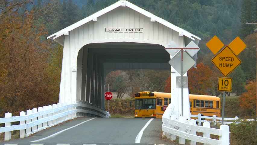 SUNNY VALLEY, OREGON - CIRCA 2011:  Grave Creek covered bridge and schoolbus