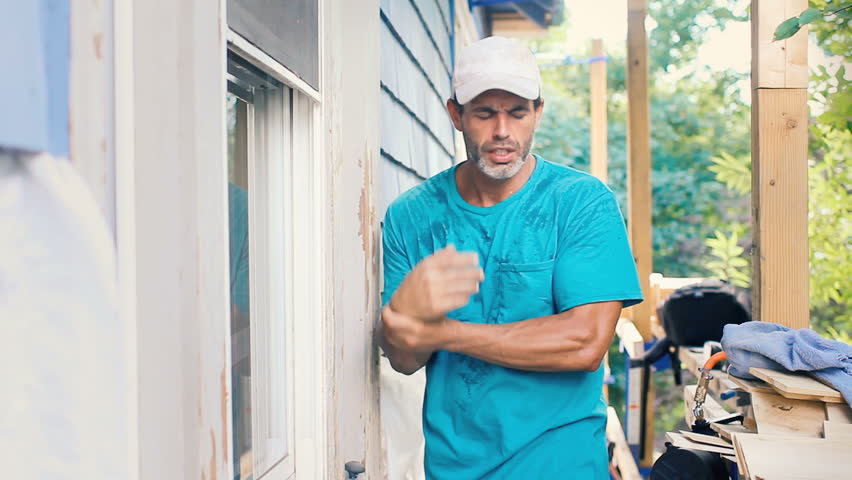 Homeowner working with wrist pain carpal tunnel syndrome injury