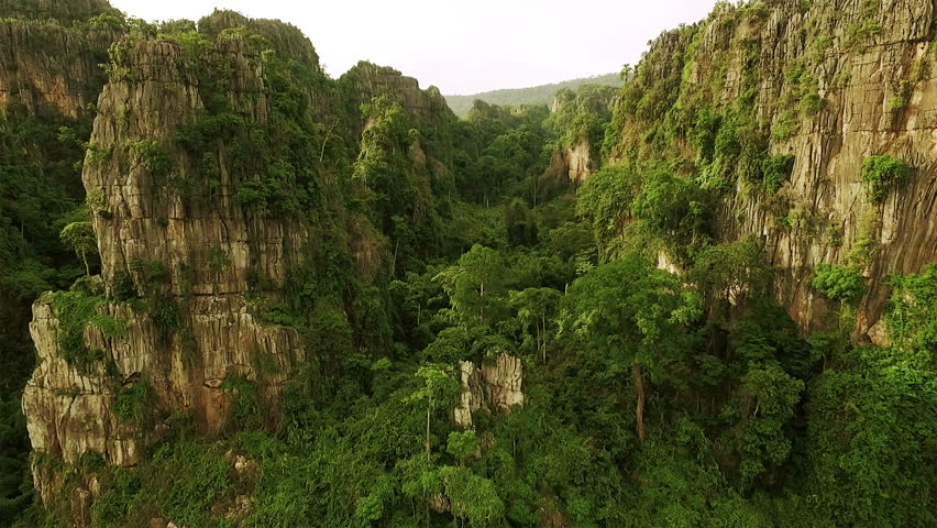 Aerial view of limestone mountain Karst, the Avatar-like mountain pass of sharp cliffs, peak forest and sinkhole landscape at Noen Maprang district of Phitsanulok Province, Thailand.