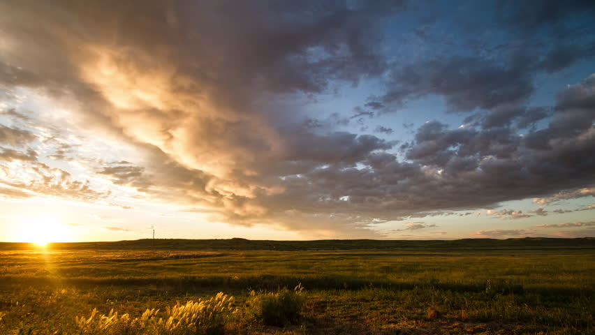 Time lapse - Clouds race towards rising sun on prairie morning - 7D SunPrairie Sunrise Flat 01