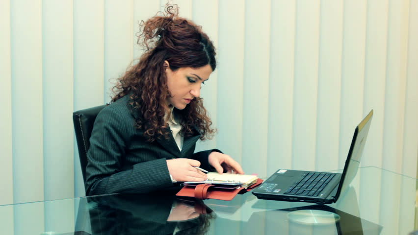 Business woman at the office desk writing | Shutterstock HD Video #1884421