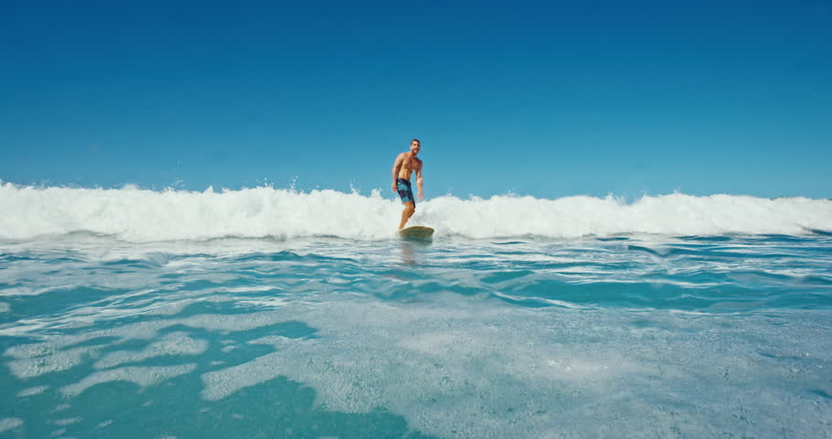 Young man having fun surfing | Shutterstock HD Video #18858971