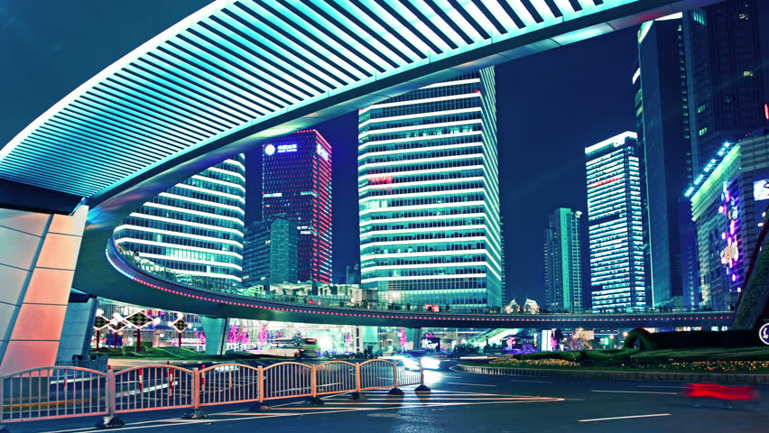 the light trails of city traffic on the modern building background in shanghai china. timelapse & loopable