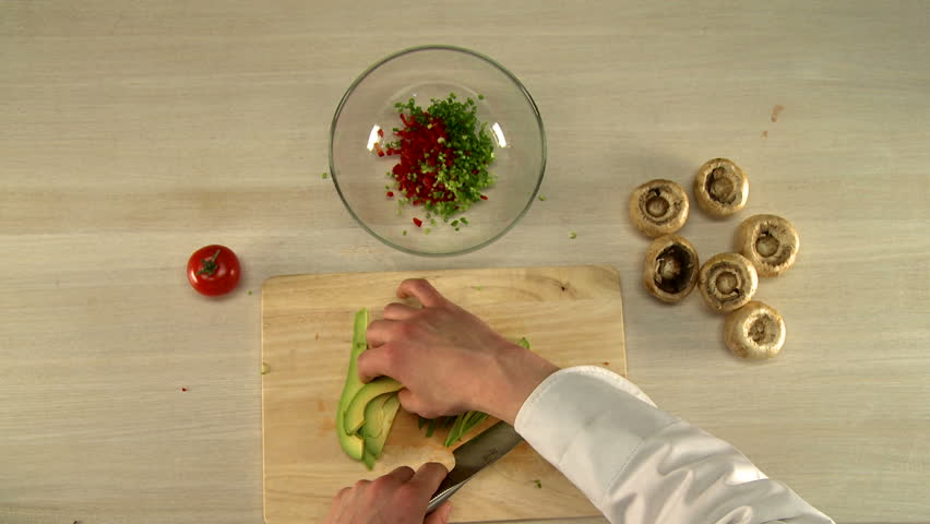 Cooking food. Top view of chef cuts avocado | Shutterstock HD Video #18922829