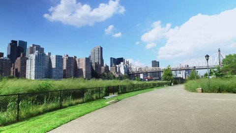 The Manhattan skyline and Ed Koch Queensboro Bridge as seen from the sidewalks and paths on Roosevelt Island.