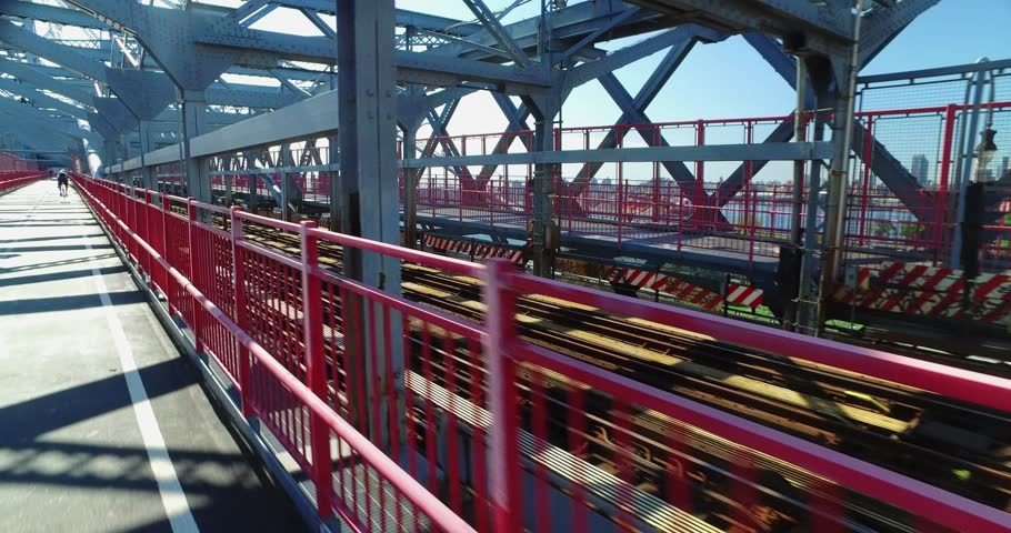 Chasing a New York City subway train on the Williamsburg Bridge over the East River between Manhattan and Brooklyn.