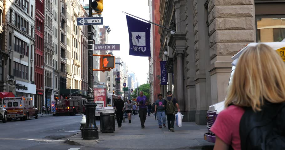 NEW YORK CITY - CIRCA MAY 2015: NYU flag on historic Building in Manhattan. New York University is the largest private institution in the United States.