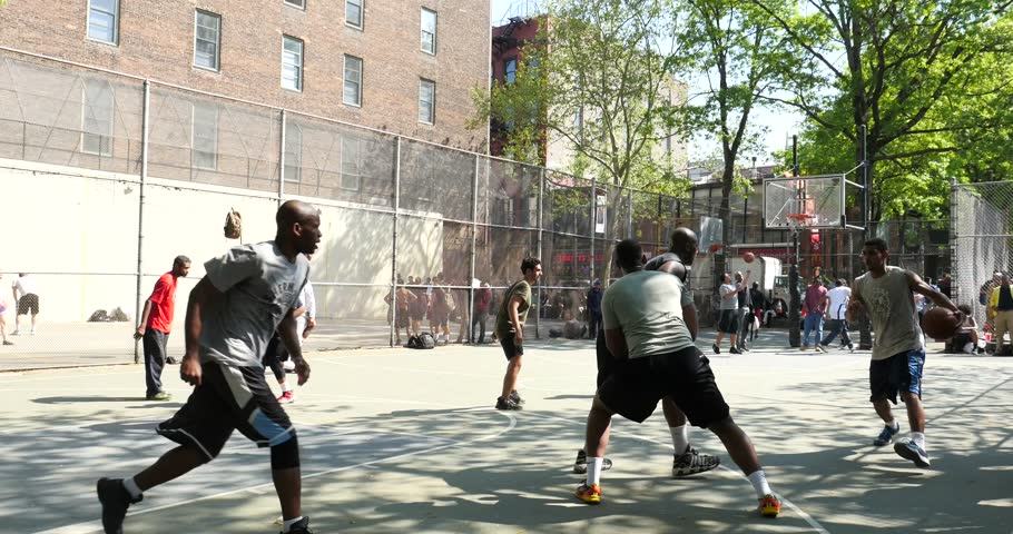 """NEW YORK CITY - CIRCA MAY 2015: West 4th Street's iconic basketball court, """"the cage"""" because a 20-foot chain-link fence boxes players, has been a proving ground for NBA stars."""