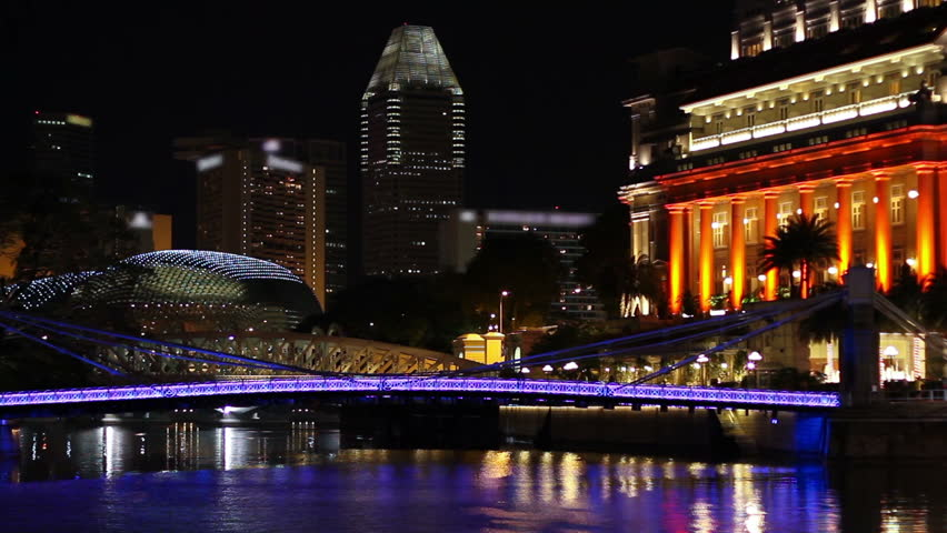 Singapore Boat Quay area at night, featuring the Cavenagh bridge, a hotel (right), one of the Esplanade twin domes and high-rise buildings. TM-signs have been blurred (Nov 2009; HDSLR).