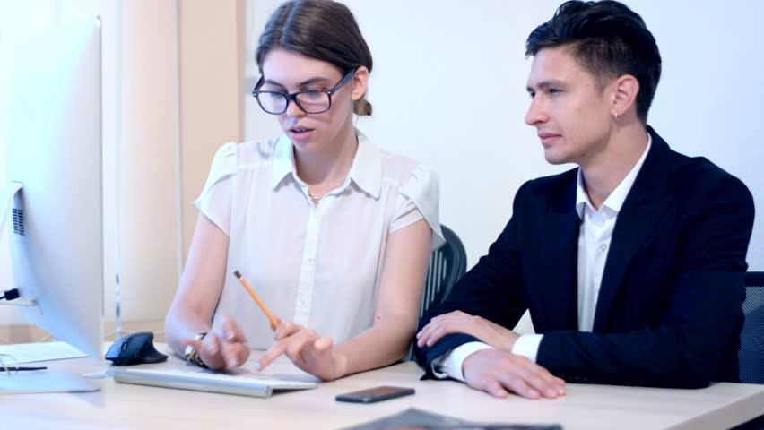 Work process of business woman and teammate businessman | Shutterstock HD Video #18967111