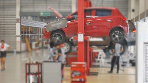 Car service center , Technician service to repair car near car lift in car service room