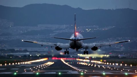 big airplane landing at Osaka-Itami International Airport during the blue hour, Japan
