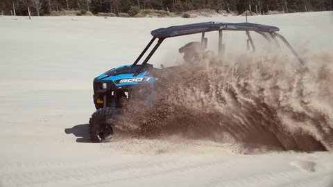 Super slow motion shot of ATV driving on sand dunes, Oregon, shot with Phantom Flex 4K