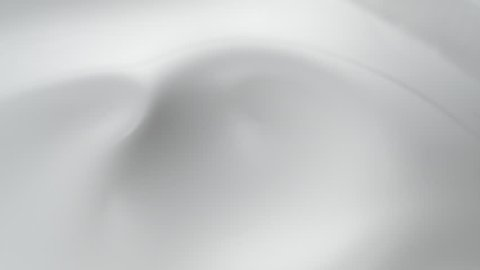 Splashes and swirl in milky liquid surface. Slow Motion. Shot with high speed camera, phantom flex 4K. Slow Motion.