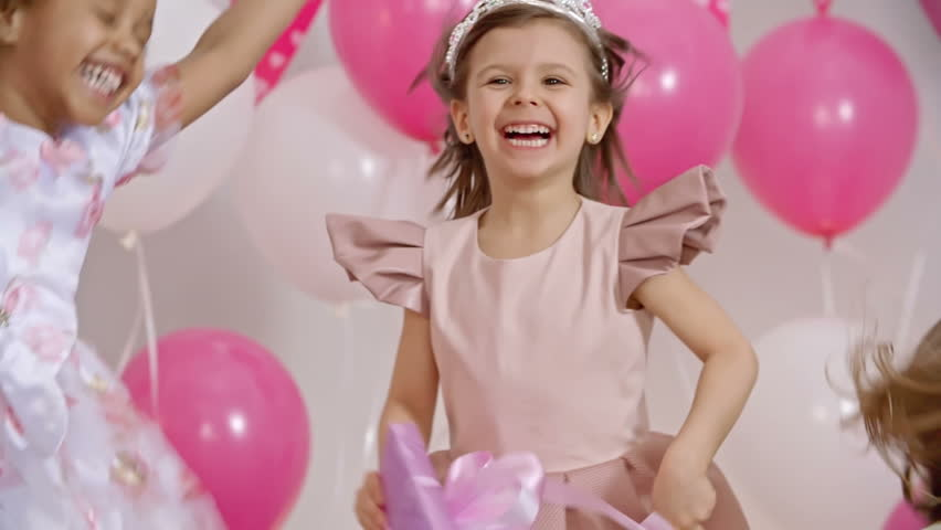 A Little Girl In Pink Dress Eating A Cotton Candy Using -6544