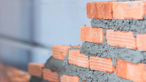 4K. Time lapse construction worker. mason bricklayer installing brick with trowel putty knife