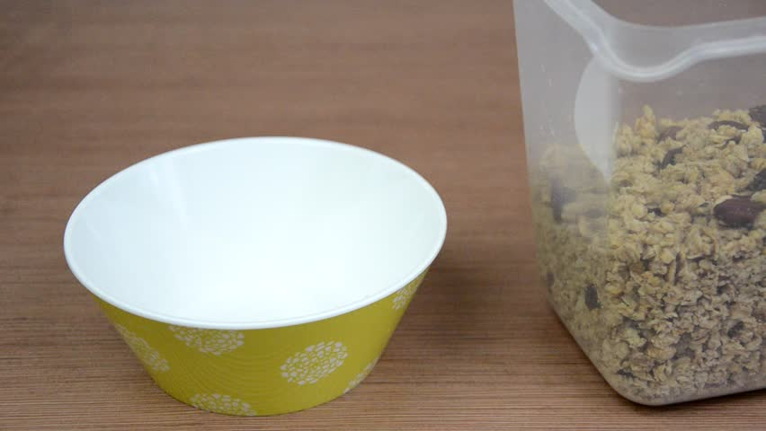 Pouring cornflakes into a bowl