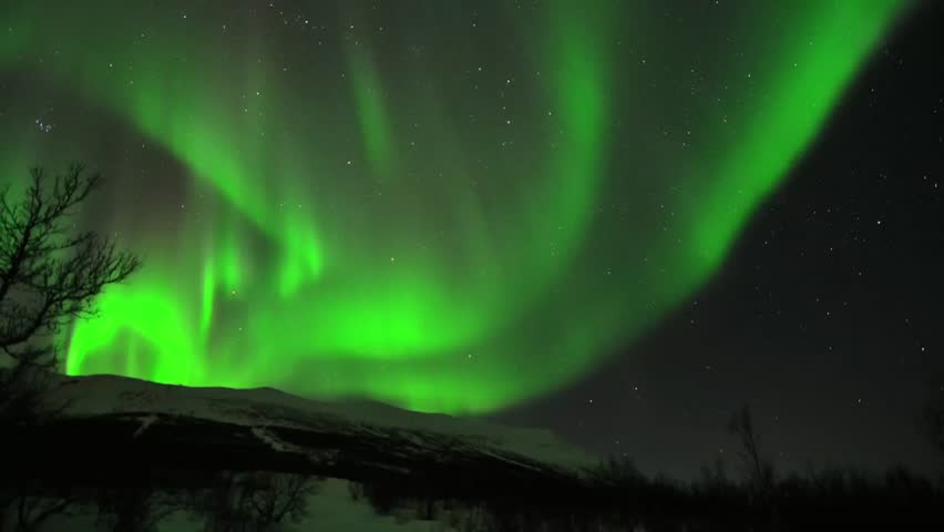 A short powerful aurora borealis dancing in the Arctic
