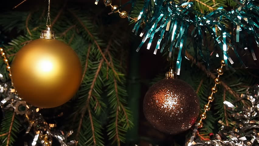 Camera Christmas Tree Ornament Part - 43: Swinging Yellow Christmas Ball On A Branch, Among The Christmas Tinsel.  Amid Flashes Garland