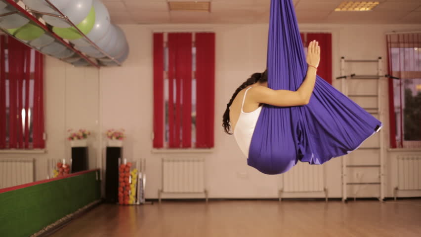 Anti-gravity Yoga, athletic woman doing yoga exercises indoor | Shutterstock HD Video #19246207