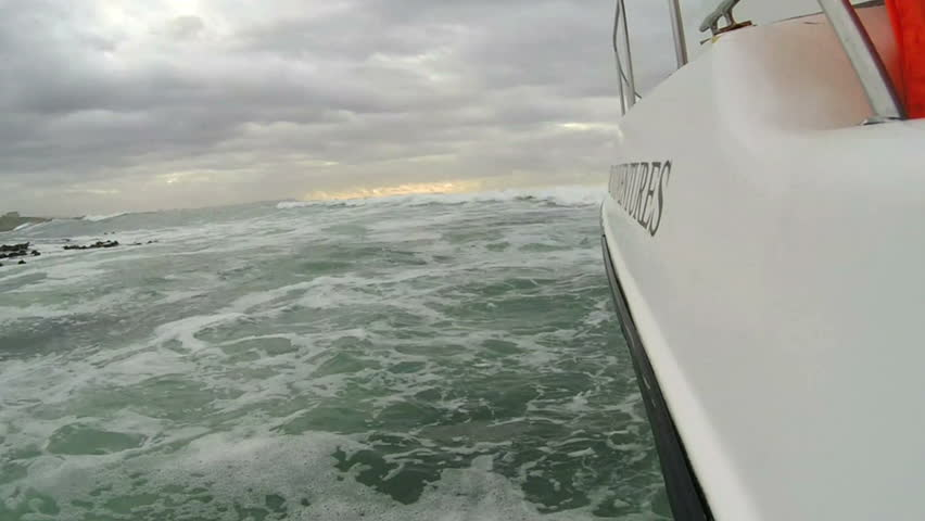 Motor boat entering rough sea on the coast of South Africa