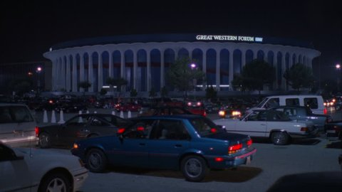night hold across full parking lot cars leaving Great Western Forum LA forum, indoor arena background House Lakers basketball team from 1967 1999 , concert venue font color red Needs additional clear