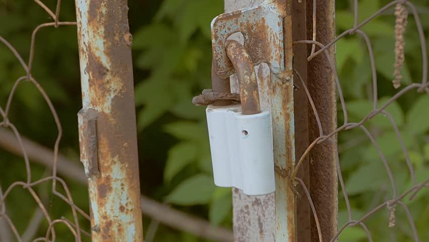 Rusty lock on a chain tied slow motion video | Shutterstock HD Video #19267021