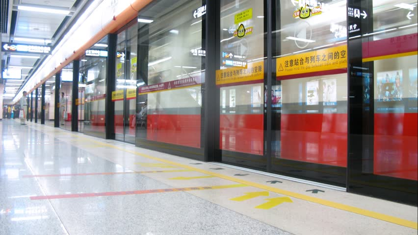 GUANGZHOU - NOV 23: (Timelapse View) Glass door is closed before train in subway, on Nov 23, 2011 in Guangzhou, Guangdong, China