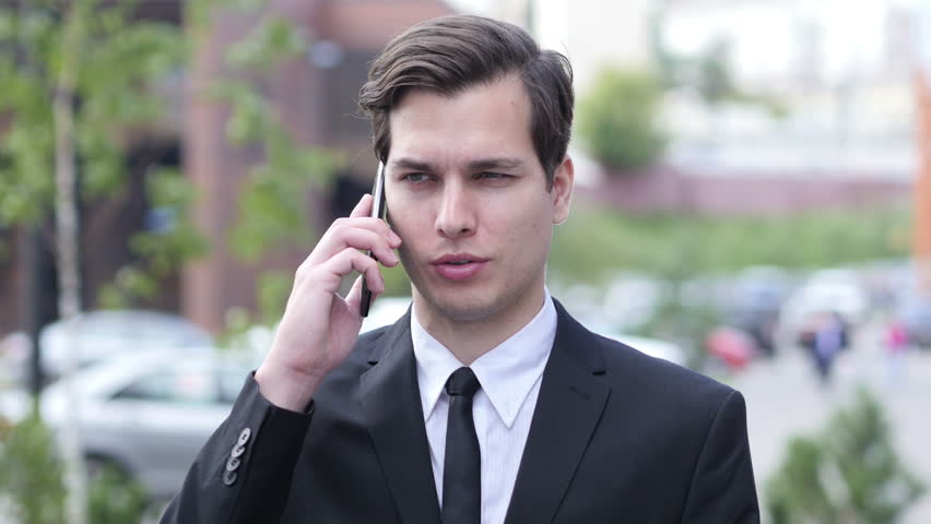 Outdoor Businessman Talking on Phone Call, Discussing Project | Shutterstock HD Video #19306171