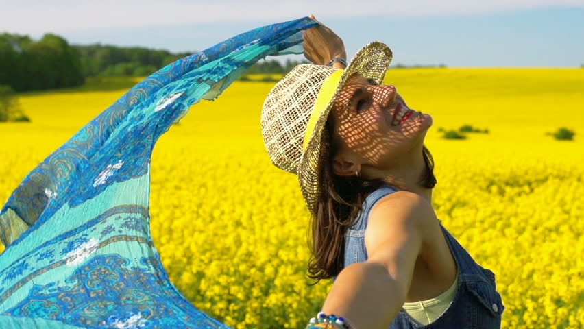 Beautiful woman holding scarf on rapeseed's field, steadycam shot, slow motion shot at 240fps  | Shutterstock HD Video #19321501